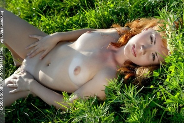 redhead outdoors with flowers in hair