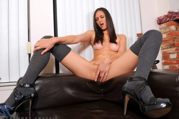 Tiffany Thompson fingers her pussy and moans