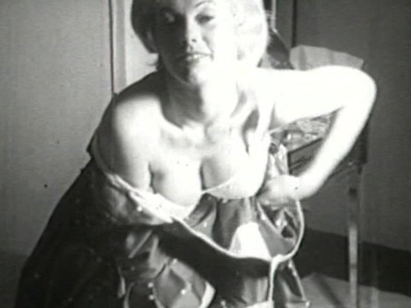 Vintage adult film of a mature blonde with big tits